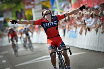 Belgian Greg Van Avermaet of BMC Racing Team celebrates as he crosses the finish line to win the fifth and last stage of the Tour De Wallonie cycling race, 144,7 km from Soignies to Thuin, on July 24, 2013 in Thuin. AFP PHOTO / BELGA PHOTO / DAVID STOCKMAN