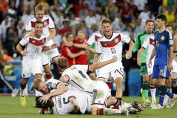 epa04314830 Players of Germany react after winning the final whistle during the FIFA World Cup 2014 final between Germany and Argentina at the Estadio do Maracana in Rio de Janeiro, Brazil, 13 July 2014. (RESTRICTIONS APPLY: Editorial Use Only, not used in association with any commercial entity - Images must not be used in any form of alert service or push service of any kind including via mobile alert services, downloads to mobile devices or MMS messaging - Images must appear as still images and must not emulate match action video footage - No alteration is made to, and no text or image is superimposed over, any published image which: (a) intentionally obscures or removes a sponsor identification image; or (b) adds or overlays the commercial identification of any third party which is not officially associated with the FIFA World Cup) EPA/KAMIL KRZACZYNSKI EDITORIAL USE ONLY