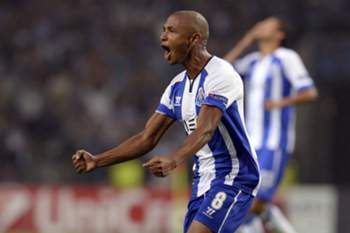 FC Porto's Argelian forward, Yacine Brahimi, celebrates after scoring a goal against LOSC Lille during their UEFA Champions League play-off second leg soccer match, held at Dragao stadium, Porto, Portugal, 26 August 2014.