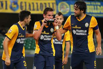 Verona's forward Juanito Gomez (C) celebrates with his teammates after scoring the winning goal during the Italian Serie A soccer match between Hellas Verona FC and US Palermo at Benegodi Stadium in Verona, Italy, 15 September 2014. Hellas won 2-1.