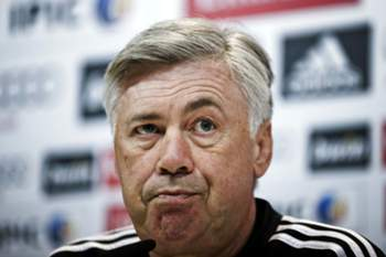 epa04559525 Head coach of Real Madrid, Italian Carlo Ancelotti, holds a press conference following a training session on the eve of their Spanish King's Cup Round of 16 return match against Atletico Madrid at the Valdebebas sports complex, in the outskirts of Madrid, Spain, 14 January 2015. EPA/Emilio Naranjo