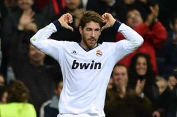 Real Madrid's defender Sergio Ramos celebrates after scoring his team's second goal during the Spanish League football match Real Madrid vs Athletic de Bilbao at the Santiago Bernabeu stadium in Madrid on November 17, 2012. AFP PHOTO / JAVIER SORIANO