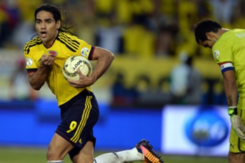 Colombia's forward Radamel Falcao Garcia celebrates after scoring a penalty against Chile during their Brazil 2014 FIFA World Cup South American qualifier match, in Barranquilla, Colombia, on October 11, 2013. AFP PHOTO / EITAN ABRAMOVICH