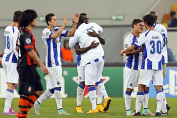 Porto players celebrate after the UEFA Champions League Group H soccer match between Shakhtar Donetsk and FC Porto in Lviv, Ukraine, 30 September 2014. The match ended 2-2.
