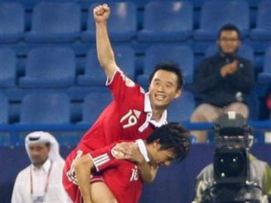 China bate Kuwait por 2-0