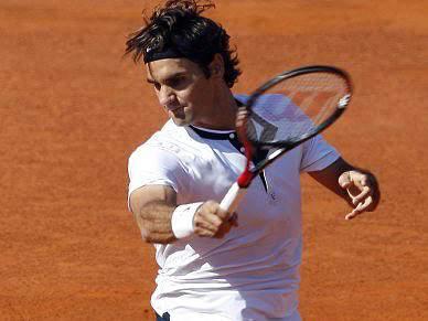 Federer segue em frente sem dificuldades