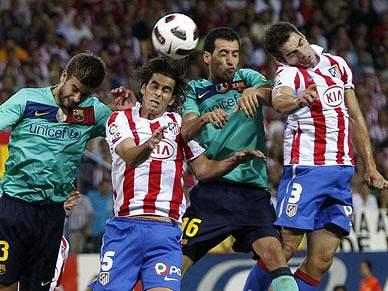 Barcelona trava Atlético, Valência líder isolado