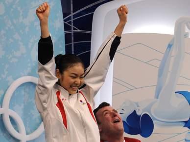 Kim Yu-Na ofusca terceiro ouro da norueguesa Marit Bjoergen