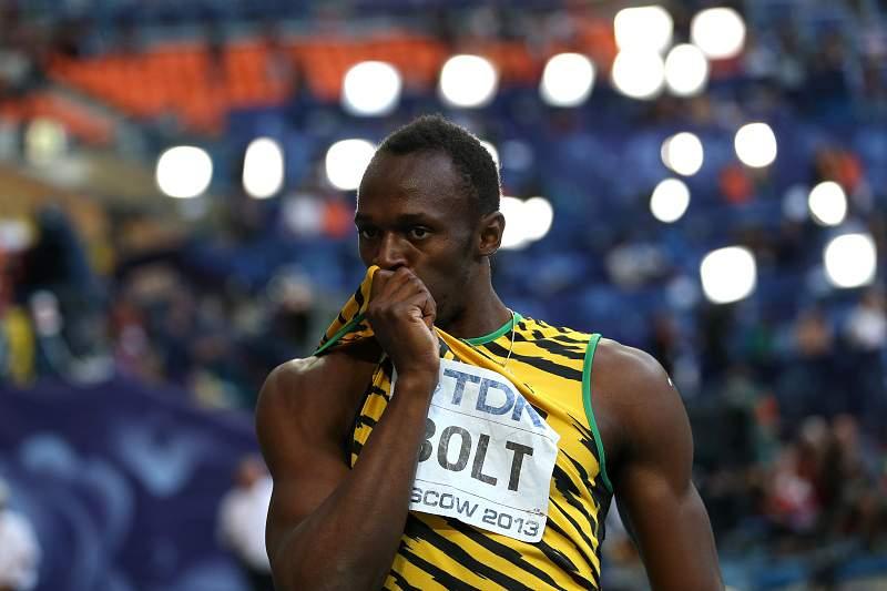 Bolt triunfa e eleva-se ao nível de Carl Lewis e Michael Johnson