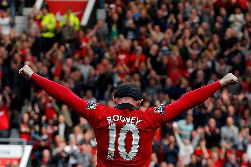 Rooney renova contrato até 2019