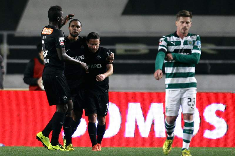 Académica´s players celebrate after scoreing a goal against Sporting during their Portuguese first League soccer match held at Coimbra Stadium, in Coimbra, Portugal, 9 March 2013.
