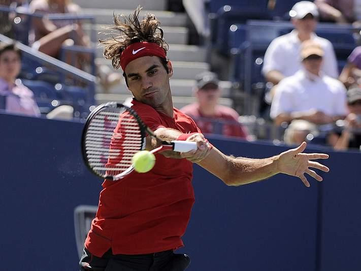 Federer passeia até à 3ª ronda