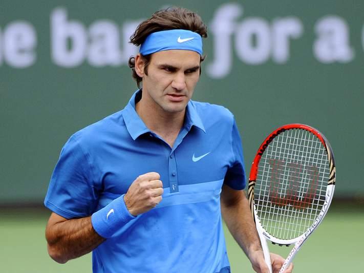 Federer passeia rumo à terceira ronda