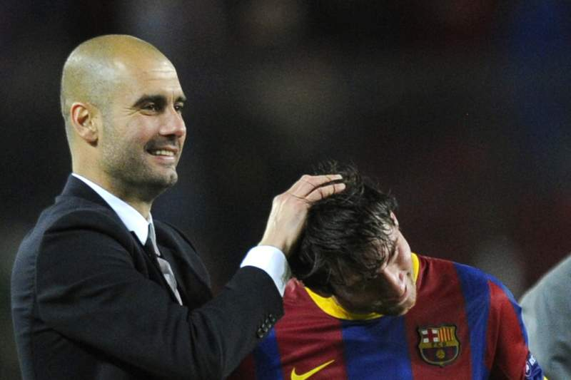 Barcelona's coach Josep Guardiola (L) celebrates with Barcelona's Argentinian forward Lionel Messi (R) and Barcelona's Brazilian defender Dani Alves (down) after the Champions League semi-final second leg football match between Barcelona and Real Madrid at the Camp Nou stadium in Barcelona on May 3, 2011. Barcelona qualified for the Champions League final after drawing 1-1 in their semi-final second leg clash with bitter rivals Real Madrid to progress 3-1 on aggregate. AFP PHOTO / JAVIER SORIAN
