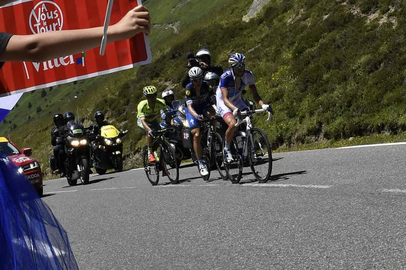 France's Thibaut Pinot (2nd R), Germany's Tony Martin (3rd R) and Poland's Rafal Majka (4th R) ride in a breakaway as fans cheer and wave French national flags during the 184 km eighth stage of the 103rd edition of the Tour de France cycling race on July 9, 2016 between Pau and Bagneres-de-Luchon. / AFP PHOTO / jeff pachoud