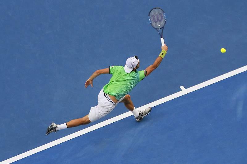 João Sousa em ação contra Andy Murray no Open da Austrália 2016. MADE NAGI/LUSA