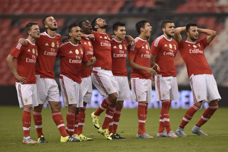 Benfica's footballers celebrate after a teammate scored a penalty during their International Champions Cup tournament match against America of Mexico at the Azteca stadium in Mexico City on July 28, 2015. Benfica won the match by penalties 4-3. AFP PHOTO/ Yuri CORTEZ