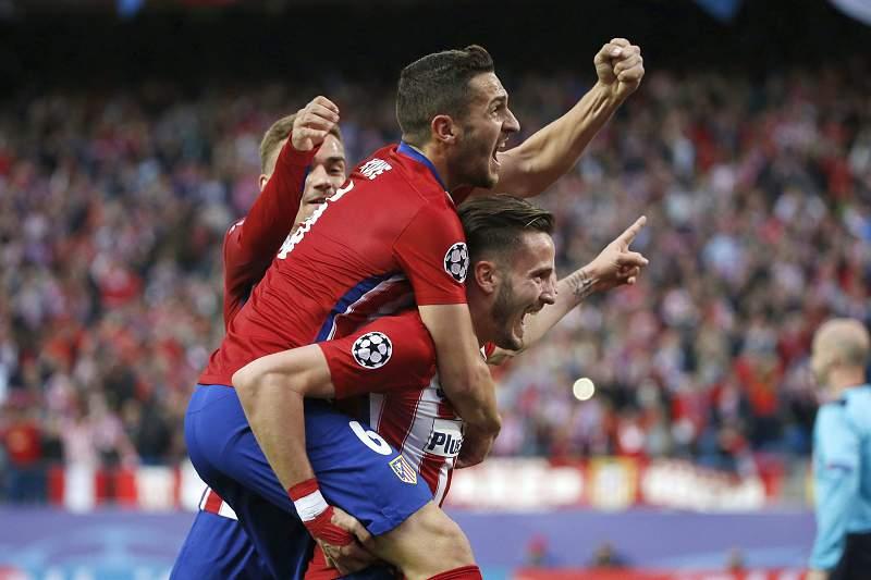 Jogadores do Atlético Madrid festejam golo