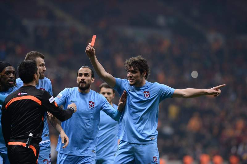 Trabzonspor's Salih Dursun shows red card to Referee Deniz Ates Bitnel after a controversial position