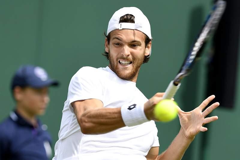 João Sousa eliminado na primeira ronda de pares em Wimbledon