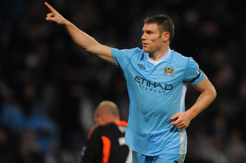 Manchester City's English footballer James Milner celebrates after scoring his team's third goal against Liverpool during their English Premier League football match in Manchester, north-west England on January 3, 2012. AFP PHOTO/ANDREW YATESRESTRICTED TO EDITORIAL USE. No use with unauthorized audio, video, data, fixture lists, club/league logos or ?live? services. Online in-match use limited to 45 images, no video emulation. No use in betting, games or single club/league/player publications.
