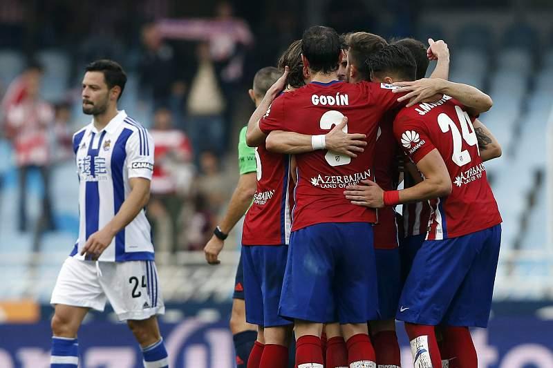 Jogadores do Atlético de Madrid celebram a vitória