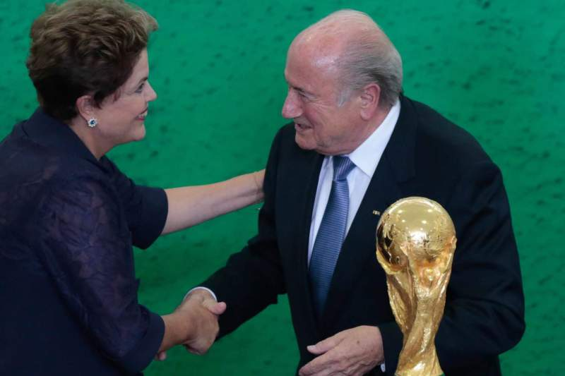 BLATTER AND ROUSSEFF MEET PRESENTING THE FIFA WORLD CUP TROPHY AND PROMISING TO MAKE THE BEST WORLD CUP OF THE HISTORY