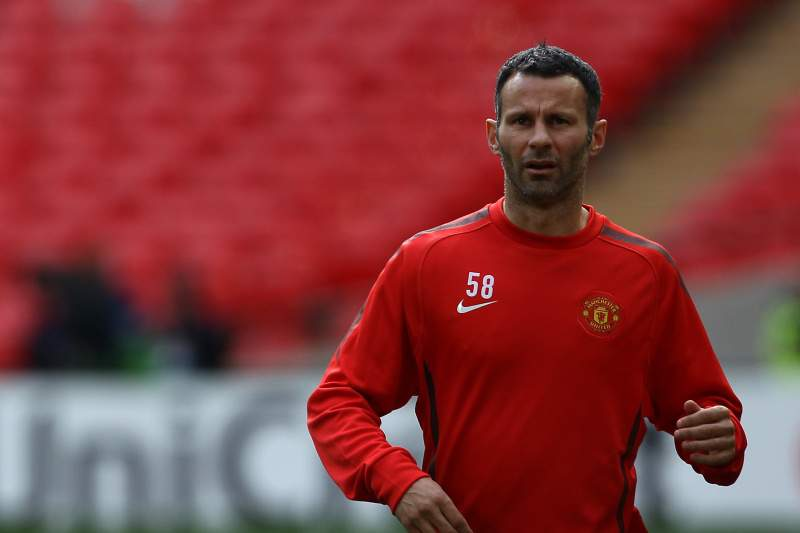 Manchester United's Welsh midfielder Ryan Giggs warms up with teammates as he takes part in a training session at Wembley stadium on the eve of the UEFA Champions League final football match FC Barcelona vs. Manchester United, on May 27, 2011 in London. AFP PHOTO/ ADRIAN DENNIS