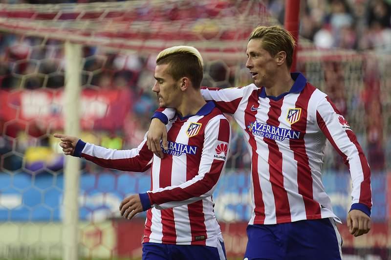Antoine Griezmann celebra um golo com Fernando Torres