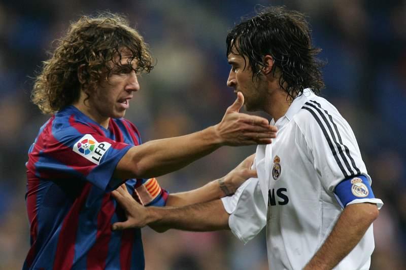 Puyol e Raúl durante um