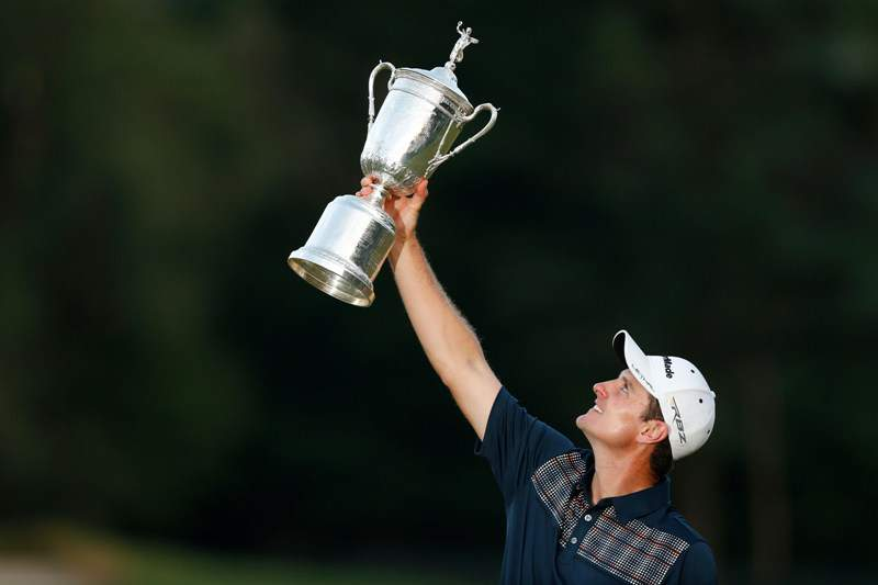 ARDMORE, PA - JUNE 16: Justin Rose of England celebrates with the U.S. Open trophy after winning the 113th U.S. Open at Merion Golf Club on June 16, 2013 in Ardmore, Pennsylvania. Scott Halleran/Getty Images/AFP