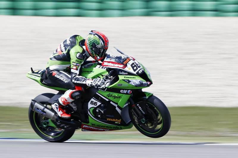 British Tom Sykes rides his Kawasaki during the first heat of the World Championship Superbike race on the TT circuit in Assen, on April 28, 2013. Sykes won the heat. AFP PHOTO / ANP /VINCENT JANNINK netherlands out