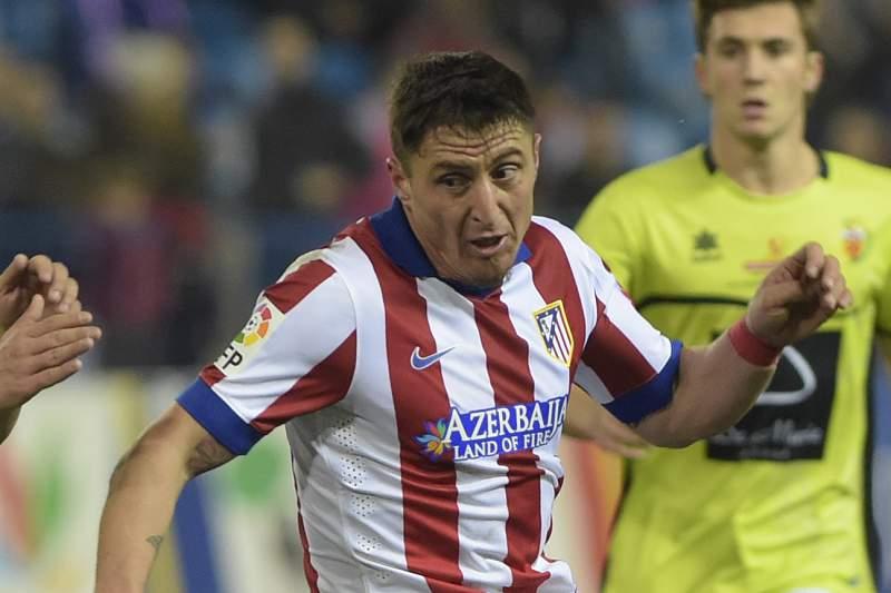 Cristian Rodríguez em ação pelo Atlético Madrid