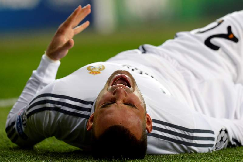 Real Madrid's forward Jese grimaces after being injured during the UEFA Champions League, round of 16, second leg football match Real Madrid CF vs FC Schalke 04 at the Santiago Bernabeu stadium in Madrid on March 18, 2014. AFP PHOTO / GERARD JULIEN