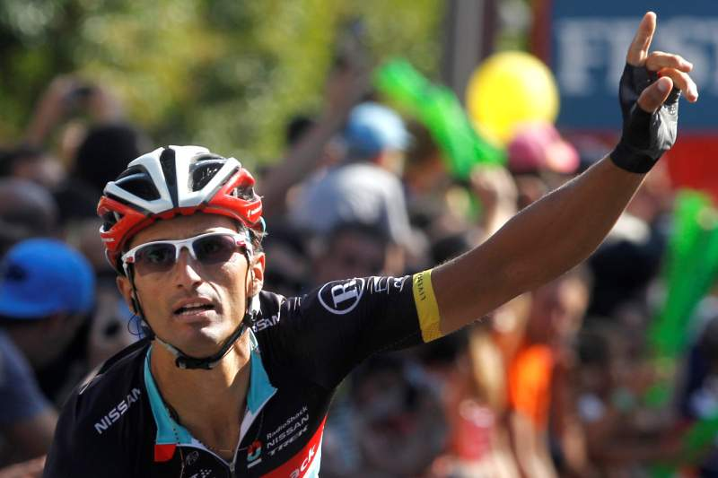 Italy's Daniele Bennati of Radioshack celebrates as he crosses the finish line to win the eighteenth stage of the Vuelta tour of Spain, a 204,5 kms ride from Aguilar de Campoo to Valladolid, on September 6, 2012. AFP PHOTO / Jaime REINA