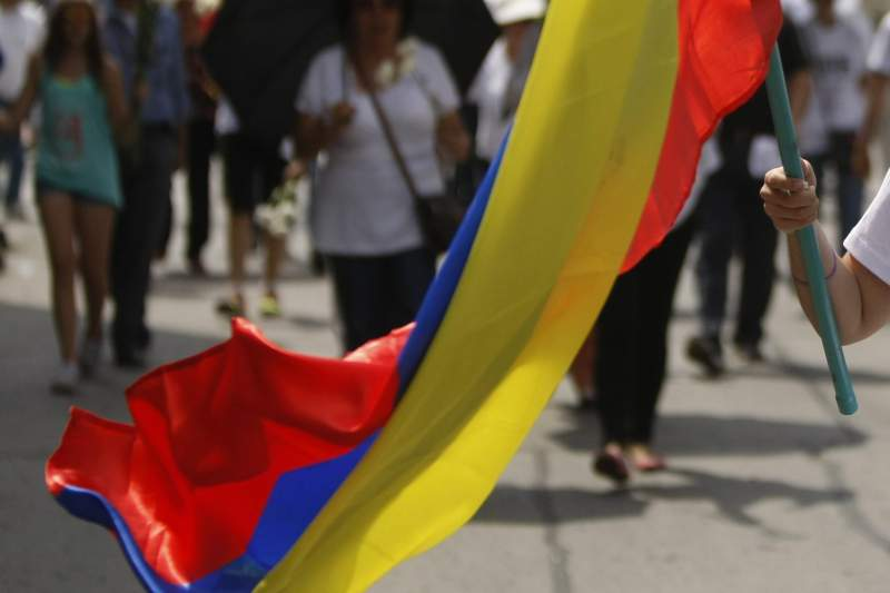 Hundreds of people rally through the streets of Cali, Colombia