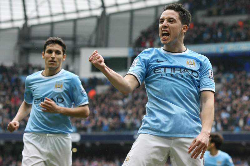 Manchester City's French midfielder Samir Nasri (R) celebrates scoring their second goal during the English Premier League football match between Manchetser City and Southampton at the Etihad Stadium in Manchester, northwest England, on April 5, 2014. AFP PHOTO / LINDSEY PARNABY RESTRICTED TO EDITORIAL USE. No use with unauthorized audio, video, data, fixture lists, club/league logos or ?live? services. Online in-match use limited to 45 images, no video emulation. No use in betting, games o