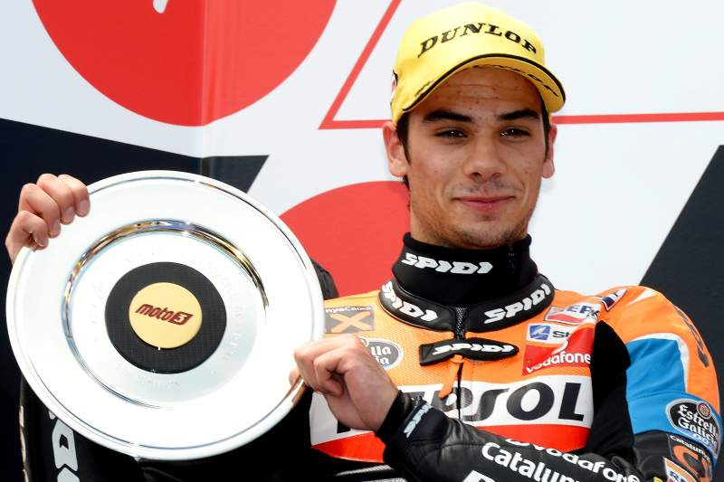 Second place-getter Suter Honda rider Miguel Oliveira of Portugal celebrates after finish in the Moto3 class at the Australian Motorcycle Grand Prix at Phillip Island on October 28, 2012. AFP PHOTO/William WEST IMAGE STRICTLY RESTRICTED TO EDITORIAL USE - STRICTLY NO COMMERCIAL USE