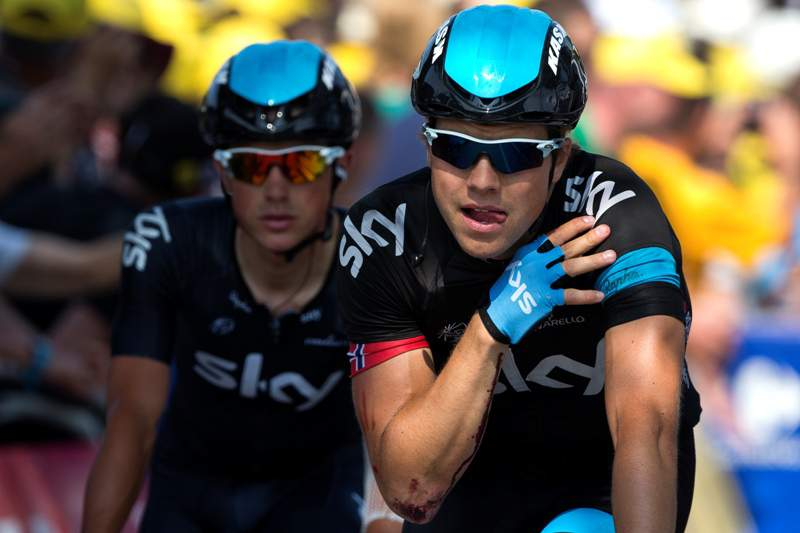Norway's Edvald Boasson Hagen (R) is seen injured at the shoulder after falling ahead of Britain's Peter Kennaugh (L) as they cross the finish line during the 218 km twelfth stage of the 100th edition of the Tour de France cycling race on July 11, 2013 between Foug