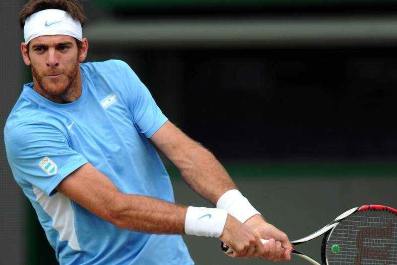 Argentina's Juan Martin del Potro plays a return to Serbia's Novak Djokovic during their London 2012 Olympic Games men's singles bronze medal match at Wimbledon in south London on August 5, 2012. AFP PHOTO / CARL COURT.