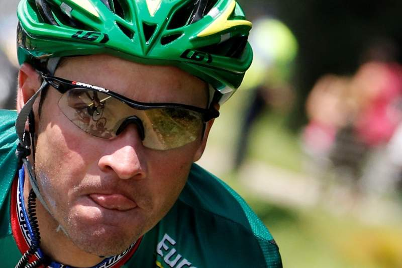 France's Thomas Voeckler climbs in a breakaway in the 194,5 km and tenth stage of the 2012 Tour de France cycling race starting in Macon and finishing in Bellegarde-sur-Valserine, center eastern France, on July 11, 2012. AFP PHOTO / JOEL SAGET