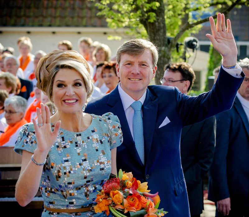Dutch King Willem-Alexander and his wife Queen Maxima wave to fans in De Rijp, The Netherlands, 26 April 2014, during the first King's Day (Koningsdag), the celebration of the birthday of the king. EPA/ROBIN VAN LONKHUIJSEN