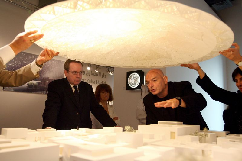 French Culture Minister Renaud Donnedieu de Vabres (L) and French architect Jean Nouvel (R) observe the model of the futur Louvre Abu Dhabi museum after a signing ceremony for a controversial agreement to build an annex of  Paris's famed Louvre art gallery in Abu Dhabi, 06March 2007. The new museum satellite, designed by Nouvel and planned for 2012, is one of five to be built as part of a