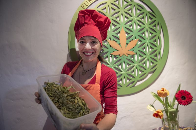 Argentine chef Natalia Revelant teaches people interested in medicinal cuisine different dishes based on cannabis during a cannabis cookery workshop in Santiago, on May 24, 2017. Cannabis as an ingredient in the kitchen to make good use of its medicinal properties, is the offer of an Argentine chef in Chile, where the use of cannabis is promoted with therapeutic uses.  / AFP PHOTO / Martin BERNETTI