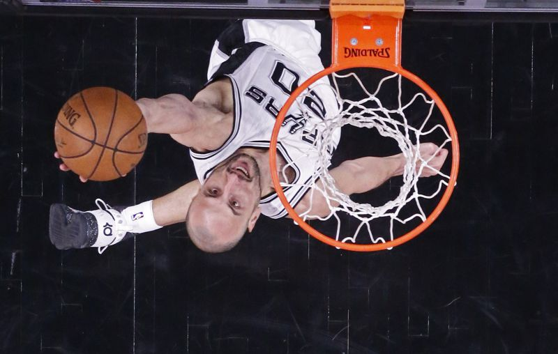 San Antonio Spurs guard Manu Ginobili of Argentina goes to the basket against the Houston Rockets in the second half of game two of their NBA Western Conference Semi-Finals playoffs basketball game in San Antonio, Texas, USA, 03 May 2017. EPA/LARRY W. SMITH