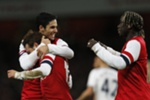 Arsenal's Spanish midfielder Santi Cazorla (2nd L) celebrates scoring the opening goal with Arsenal's Spanish midfielder Mikel Arteta (L) and Arsenal's French defender Bacary Sagna (R) during the English FA cup third round football match between Arsenal and Tottenham Hotspur at the Emirates Stadium in London on January 4, 2014. AFP PHOTO/ADRIAN DENNIS RESTRICTED TO EDITORIAL USE. No use with unauthorized audio, video, data, fixture lists, club/league logos or ?live? services. Online in-match use limited to 45 images, no video emulation. No use in betting, games or single club/league/player publications.