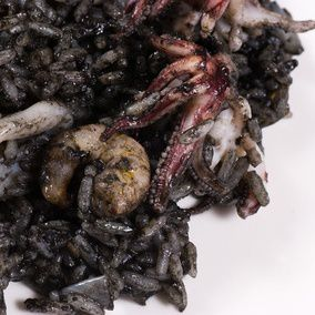 Arroz negro, traditional Spanish seafood rice cooked with squid ink