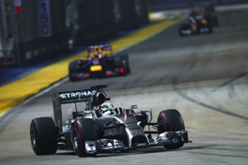 British Formula One driver Lewis Hamilton of Mercedes AMG GP in action ahead of German Formula One driver Sebastian Vettel of Red Bull Racing during the Singapore Formula One Grand Prix night race in Singapore, 21 September 2014.