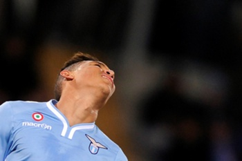 Lazio's Colombian forward Brayan Perea reacts during the Serie A football match between the Lazio and Napoli at Rome's Olympic Stadium on December 2, 2013. AFP PHOTO/ FILIPPO MONTEFORTE
