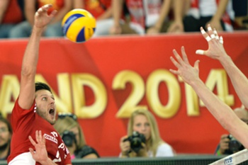 Poland's Michal Winiarski spikes during the FIVB Men's Volleyball World Championship Round 3 match Russia vs Poland in Lodz, Poland on September 18, 2014.